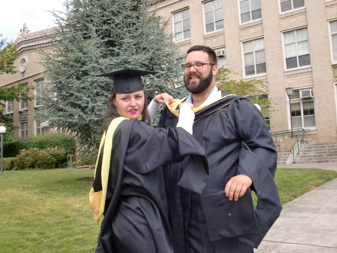 Turner and his classmate Serenity Ibsen at Emporia's Graduation. Even though Turner finishes his brogram in December, he celebrated with his cohort. Photographer credit: Marta Murvosh