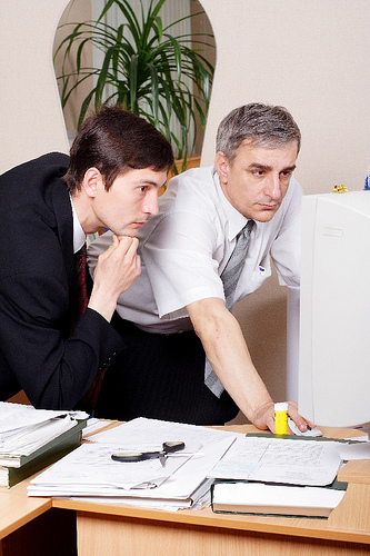 Two dudes working together