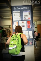 Student looking at Info Board