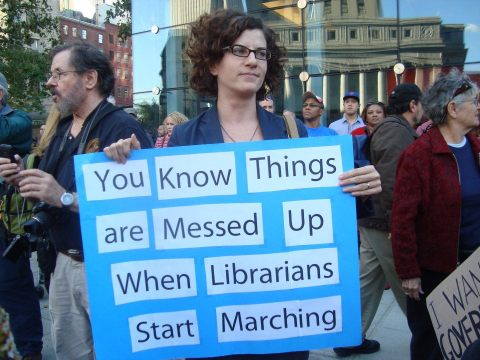 marching librarian sign