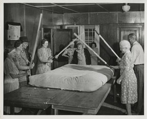 I love this photo, though I have no idea what's going on. I believe they're testing a homemade cotton mattress. (courtesy Nancy B. Leidenfrost Papers, National Agricultural Library)