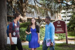 Grace (center) posing in front of Dirac Science Library courtesy of FSU Library Marketing