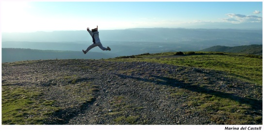 A person leaping into the air, from a field