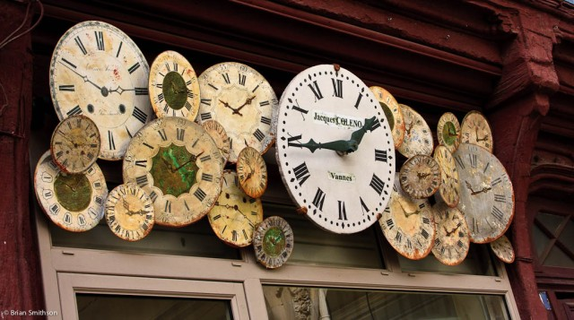 Decorative clock faces above a clock shopfront in Vannes, France