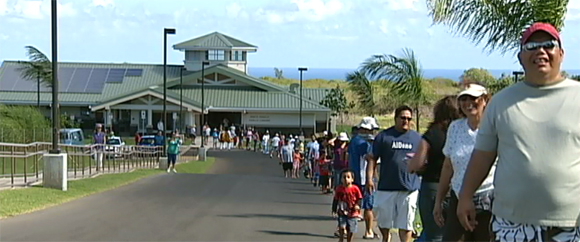 Residents of North Kohala, lined up to pass books to the new library. Image courtesy of bigislandvideonews.com